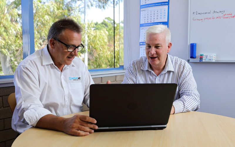 Two men discussing project on the laptop