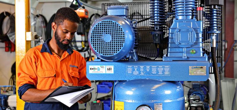 Man checking the quality of air compressor