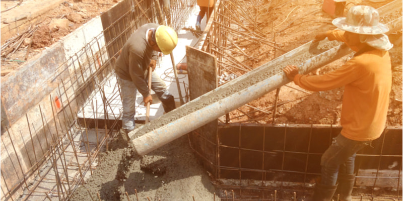 Workers were pouring concrete foundations for buildings