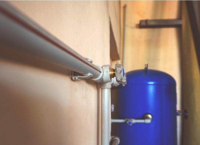 Control of air compressor using plastic pipe