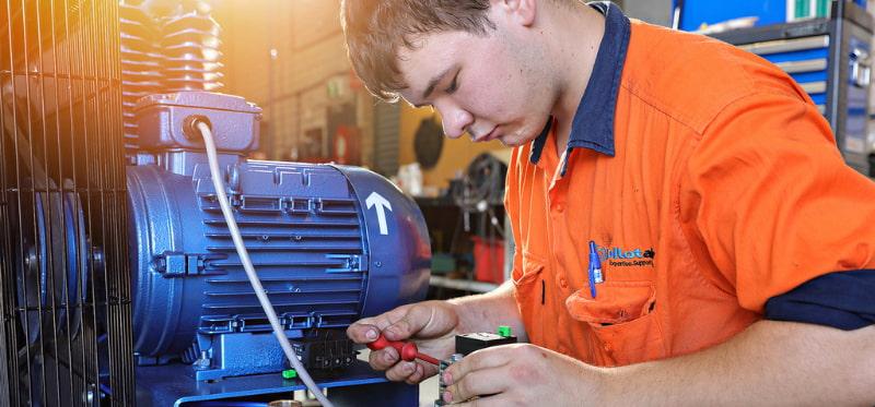 Man repairing the air compressor